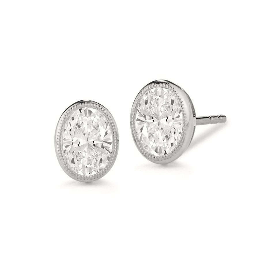 Miss Diamond Ring oval stud earrings with milgrain detail