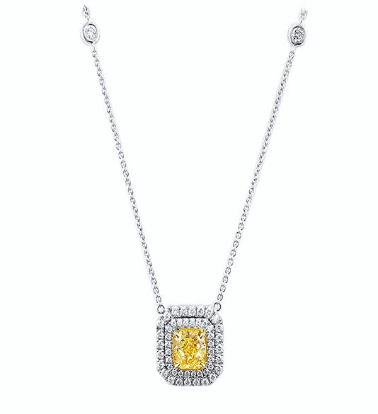 Miss Diamond Ring fancy yellow radiant diamond with round brilliant diamonds