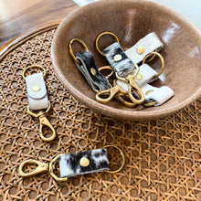 Load image into Gallery viewer, Cowhide Keychain (available in salt + pepper and white)