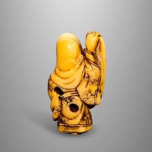 Netsuke - Jurojin Holding the Scroll of Life