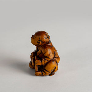 Netsuke – Farmer Sharpening His Sickle