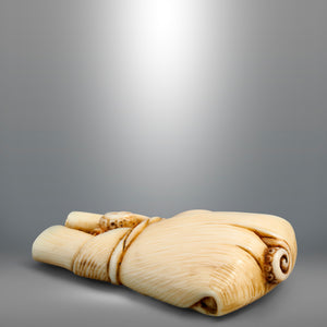 Netsuke – Octopus wrapped in a bamboo leaf