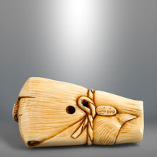 Load image into Gallery viewer, Netsuke – Octopus wrapped in a bamboo leaf