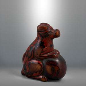 Netsuke – Lacquered Dog Resting on a Ball