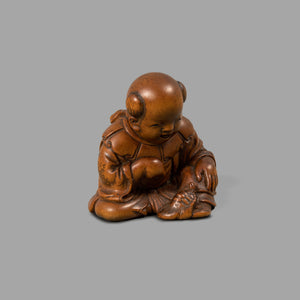Netsuke – Boy with minogame