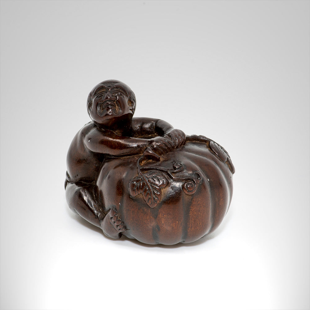 Netsuke - Farmer with large pumpkin