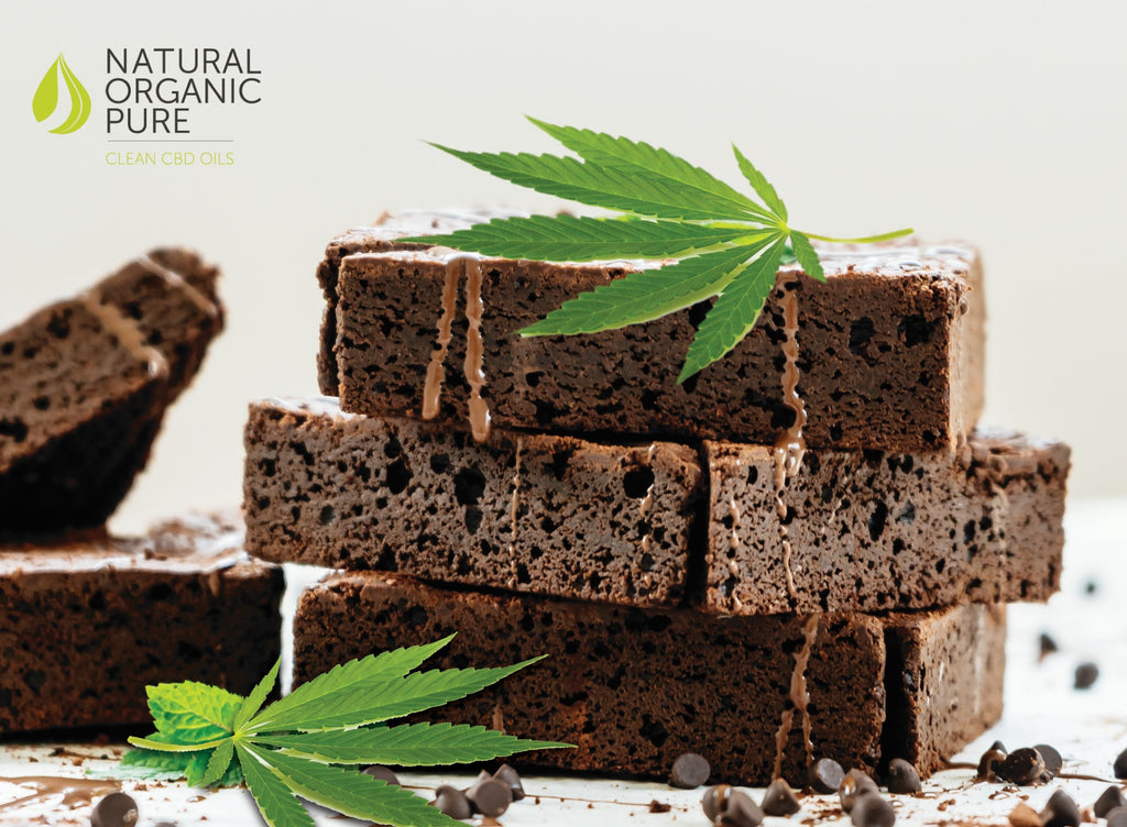 CBD Edibles | CBD Infused brownies piled with cannabis leaf | Natural organic pure clean CBD Oils