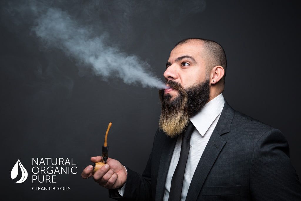 cbd vape oil | trendy man in suit with beard vaping cb | cbd vape | natural organic pure clean cbd oils