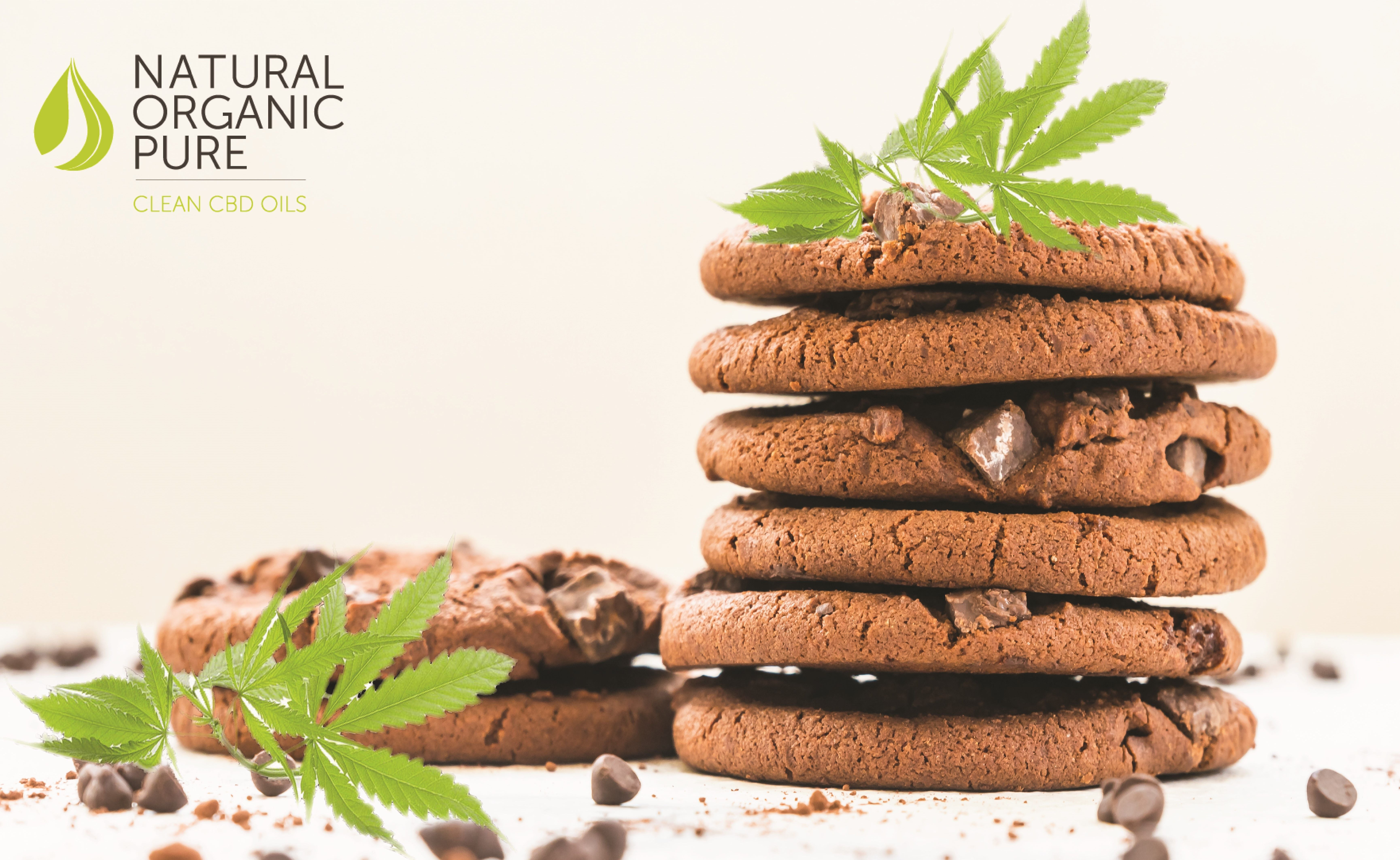 CBD Edibles | Pile of CBD infused cookies with cannabis leaf | Natural Organic Pure Clean CBD Oilsi