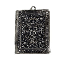 Antique Nurses Locket Pendant With Caduceus Symbol at bitchinretro.com