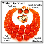 West Germany Orange Beaded Necklace With Enameled Brooch and Sarah Coventry Earrings at bitchinretro.com