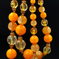 Vintage Orange Moonglow Necklace with Faceted Beads and Gold Filigree Caps
