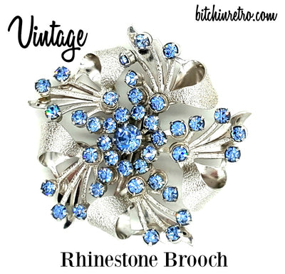 Vintage Blue Rhinestone Brooch With Silver Floral and Bow Design