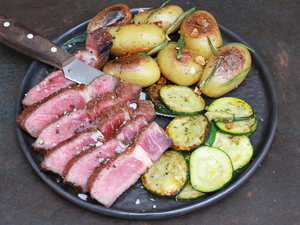 Ribeye steak with grilled potatoes