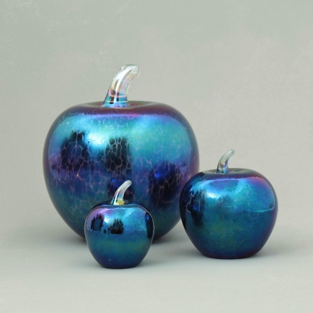 set of handmade glass apples in dark iridescent
