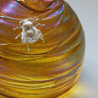 Glass skep beehive shaped paperweight with sterling silver bee close up