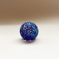 small round blue speckled glass paperweight