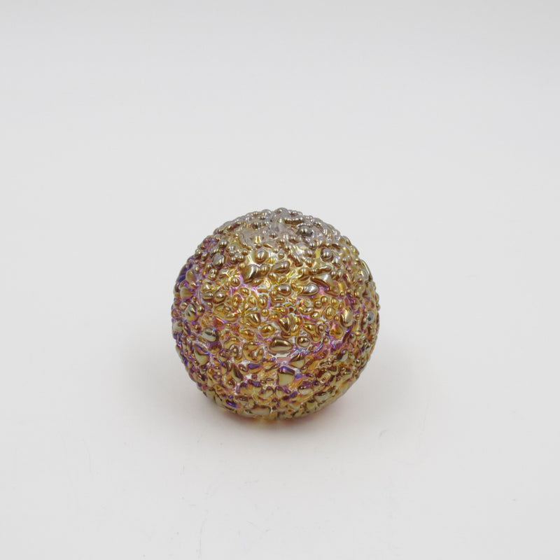 gold iridescent speckled glass paperweight