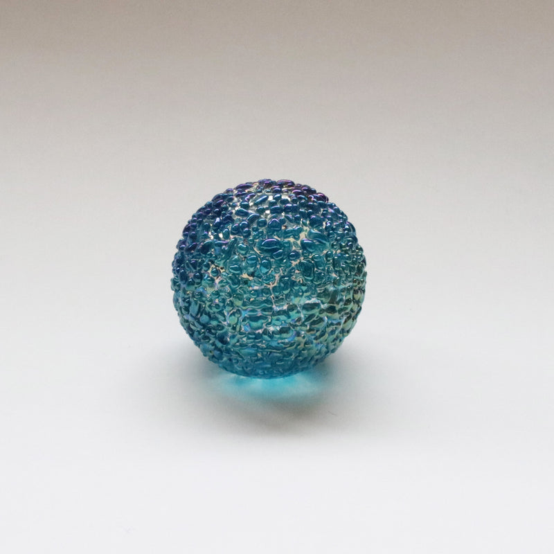 iridescent capriblue speckled paperweight