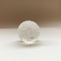 giridescent glass speckled paperweight