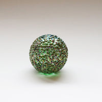 iridescent green speckled glass paperweight