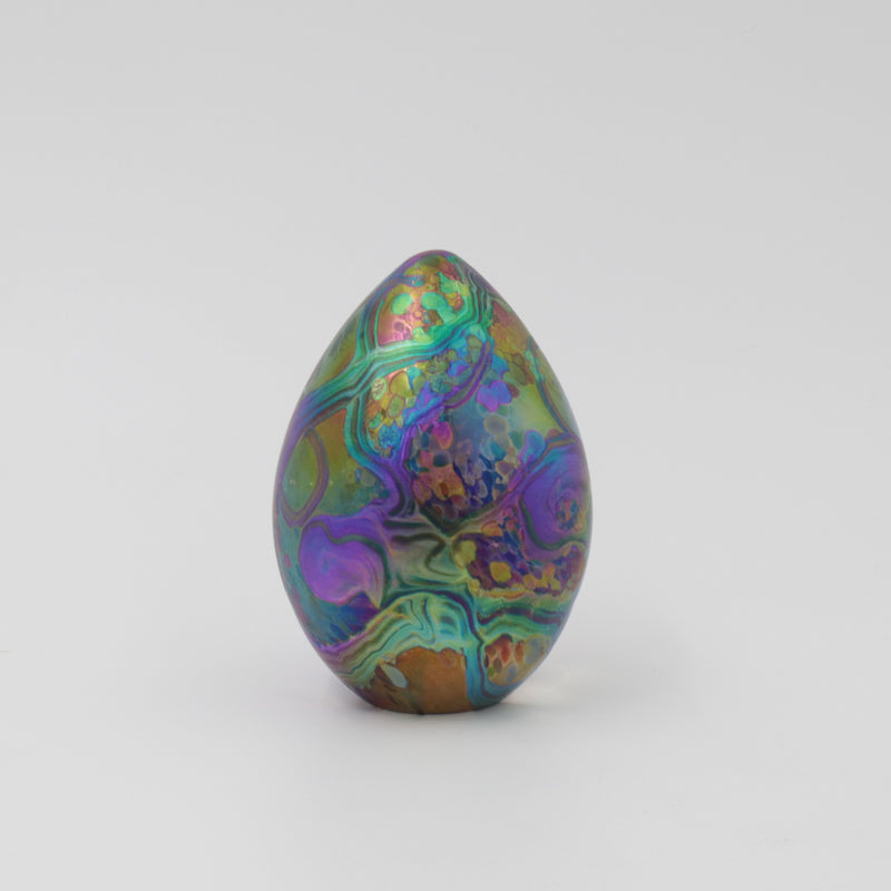 Hanmade glass goose egg shaped paperweight in iridescent multi colours