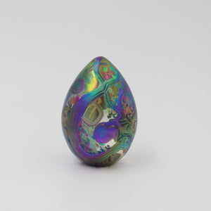 Handmade glass goose egg shaped paperweight in iridescent multi colours