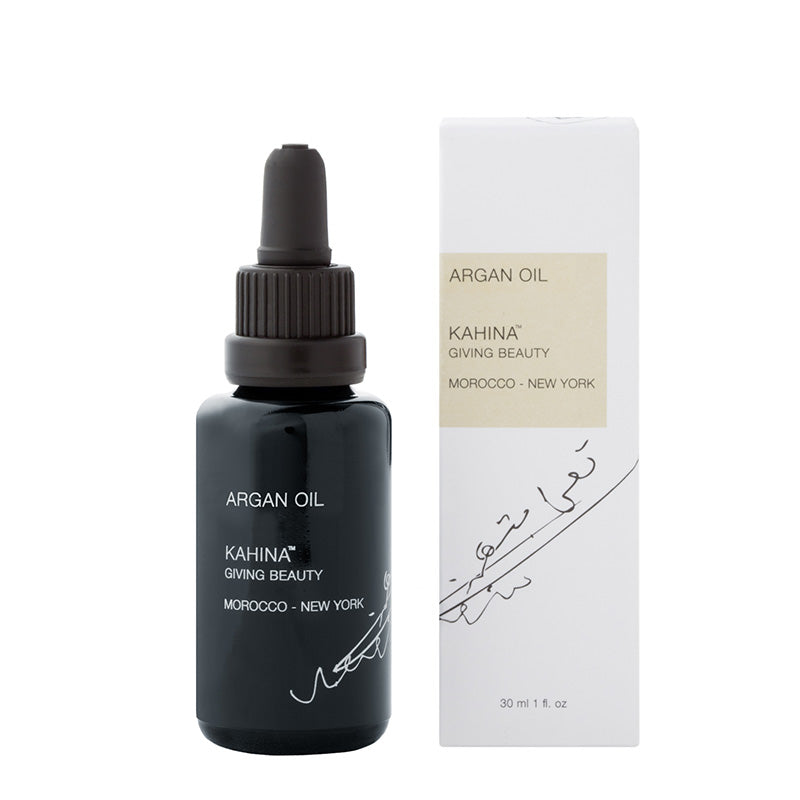 Light, non-greasy Kahina Giving Beauty argan oil, in a violet glass bottle and recycled cardboard box.