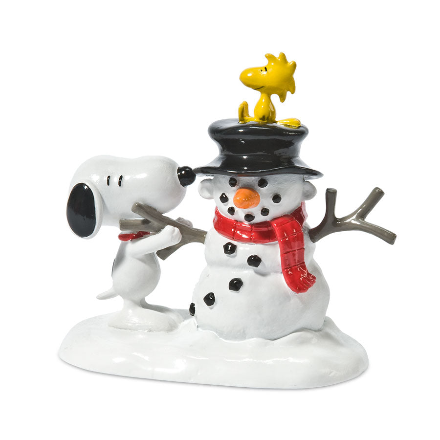 Snoopy Builds A Snowman