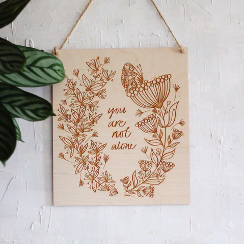 'you are not alone' etched floral wooden wall plaque