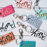 home | tag style keyrings in various colourways