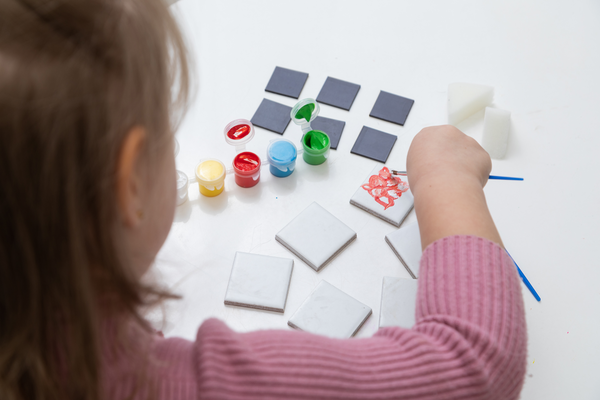 young girl painting tiles from 4-in-1 Ultimate Craft Set