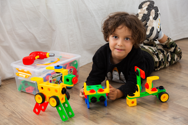 Young Boy playing with Educational Building toy set