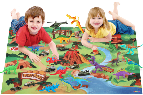 Two young kids playing on a dinosaur themed play mat