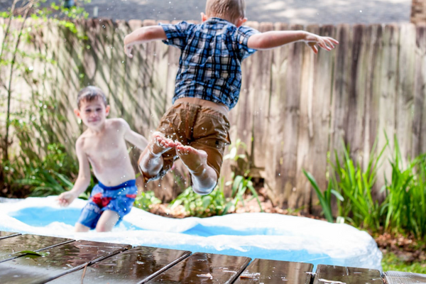 two boys swimming in backyard on fathers day