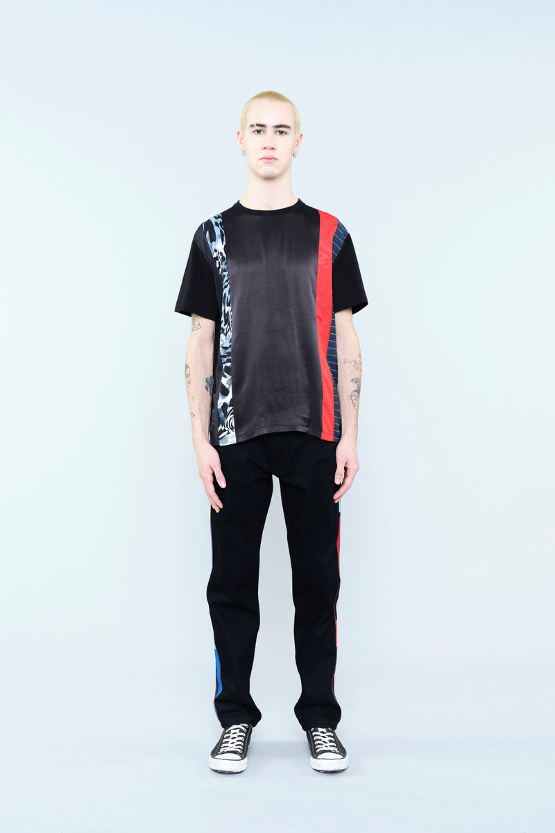 BLACK T-SHIRT WITH LEOPARD SPOTS AND CONTRASTING RED INSERTS