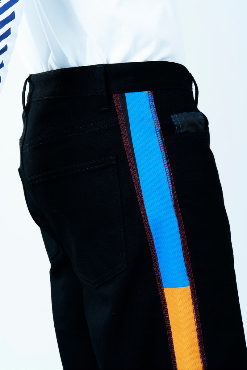JEANS IN BLACK DENIM WITH RE/KOCHÉ-INSPIRED INSERTS