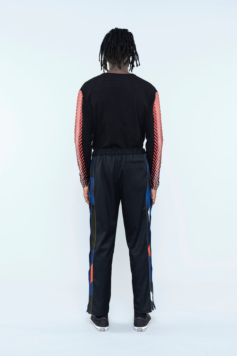TROUSERS IN HI-TECH WOOL CLOTH WITH RE/KOCHÉ-INSPIRED INSERTS
