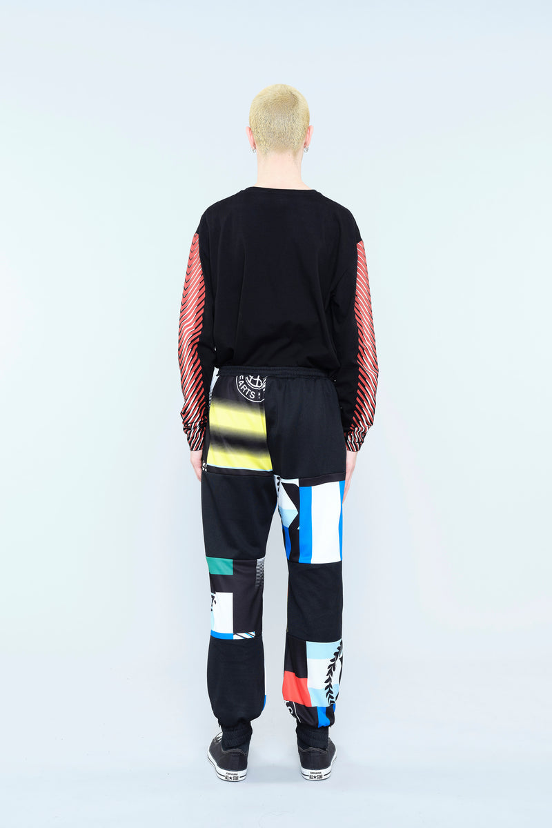 TROUSERS WITH RE/KOCHÉ-INSPIRED PATCHWORK