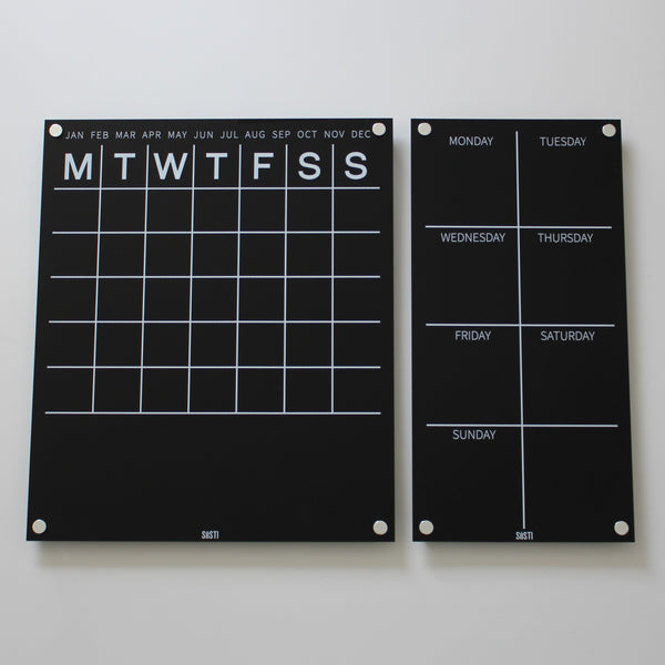 Black and white acrylic perpetual monthly wall calendar with notes