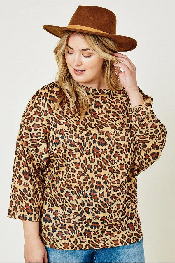 Front view. Leopard print  boat neck top. Plus size clothing Canada