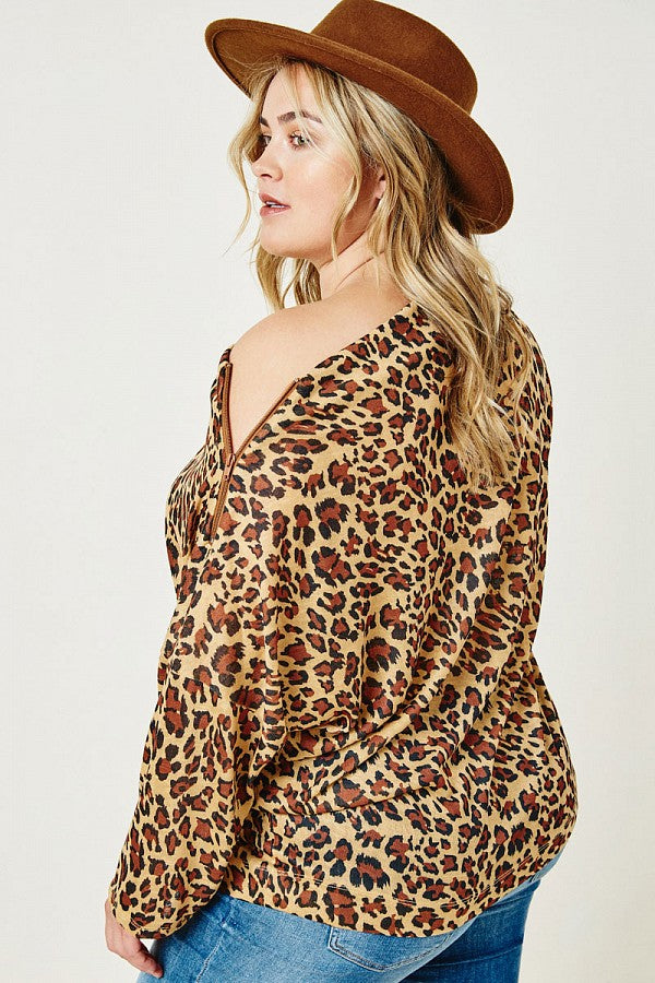Side view. Leopard print  boat neck top. Plus size clothing Canada