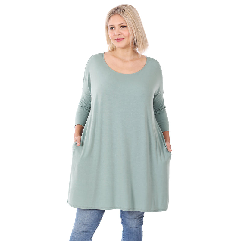 Plus size women's flowy 3/4 sleeve tunic top in light green. Women's boutique clothing Canada. Plus size boutique clothing Canada,