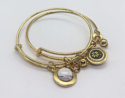 Gold double side bangle with white stone