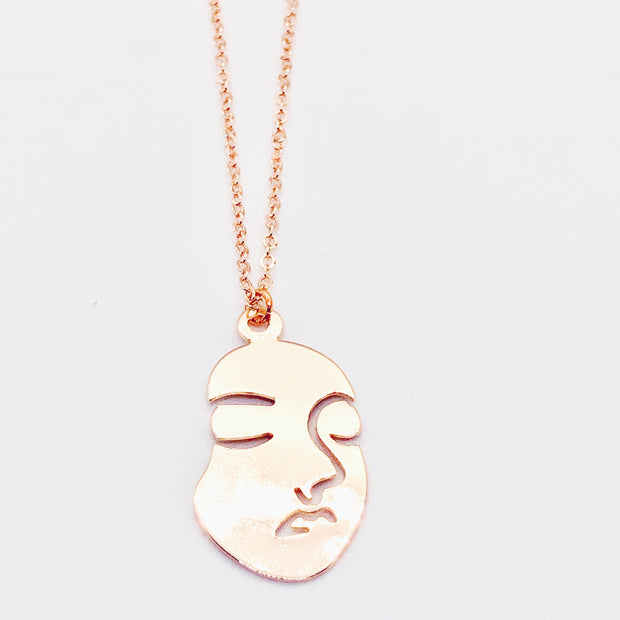 Long Gold Face Necklace