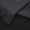 Folded detail of scarf which has been dip dyed in subtle shades of dark grey to almost black. Made from wool, yak and cashmere, a soft and luxurious scarf from Thread Tales company