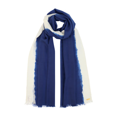 Model wearing floating blue sustainable wool scarf with white soft blurred edge from Thread Tales