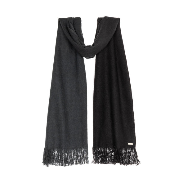 Hanging scarf dip dyed in subtle shades of dark grey to almost black. Made from wool, yak and cashmere, a soft and luxurious scarf from Thread Tales company