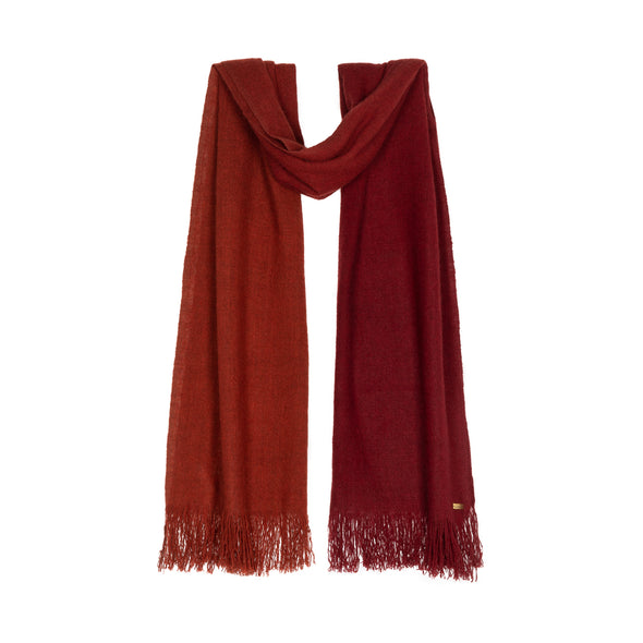 Hanging scarf which has been dip dyed in subtle shades of rust to dark red crimson. Made from wool, yak and cashmere, a soft and luxurious scarf from Thread Tales company