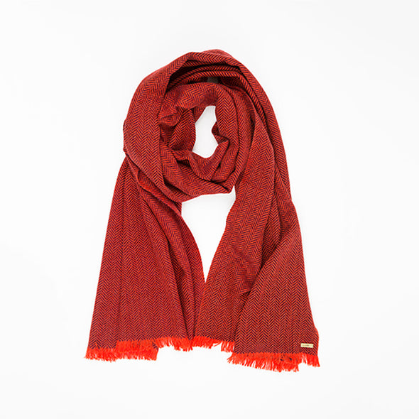 Folded neckloop of scarf in two tones of red herringbone weave in cashmere yak wool hand-finished with vibrant short fringe from Thread Tales company